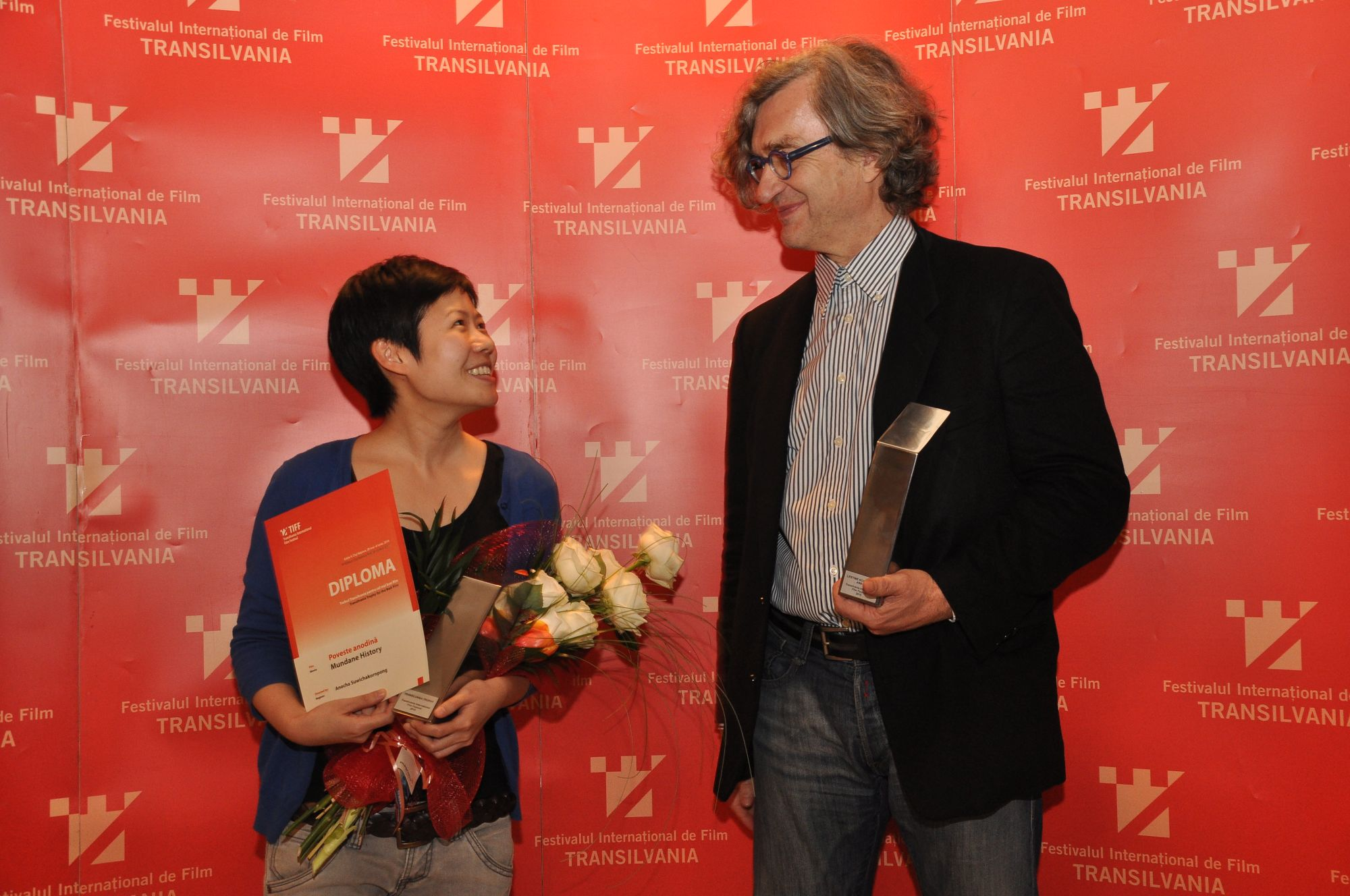 Anocha Suwichakornpong, the winner of this year's Transilvania Trophy for her debut Mundane History, with European Film Academy President Wim Wenders who was honoured with the Lifetime Achievement Award  presented to an outstanding personality of European cinema. Courtesy TIFF