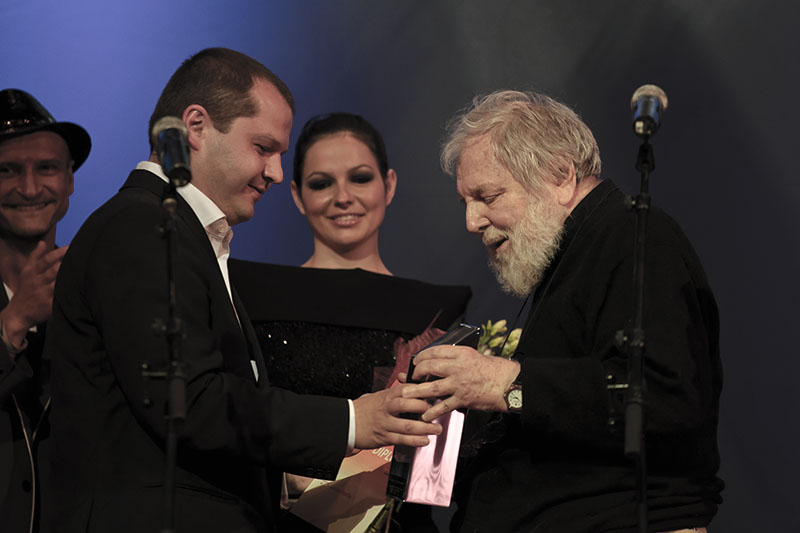 In photo: Lucian Pintilie receives his Excellency Award from Corneliu Porumboiu, with TIFF's Mihai Chirilov (left) looking on, courtesy  Adi Marineci
