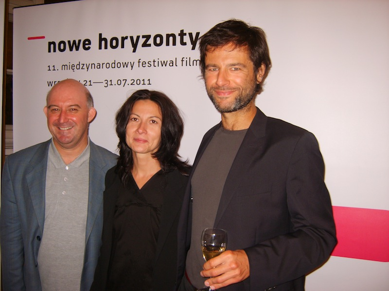 In photo, Jury member Martin Blaney with prize-winners Wilhelm and Anna Sasnal (It Looks Pretty From A Distance), courtesy Martin Blaney